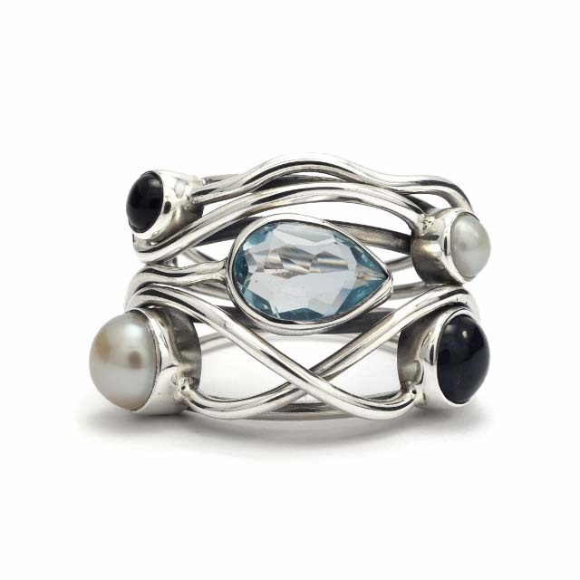 Cut blue topaz, iolite and pearl silver ring